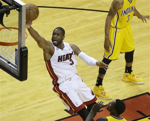 For the first time in four NBA Finals appearances, Dwyane Wade enters the series as a question mark for Miami's success. (Photo by Wilfredo Lee, Associated Press)